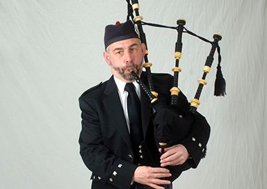 The Midlands Bagpiper - Highland piper