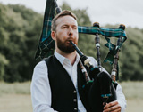 The London Bagpiper picture